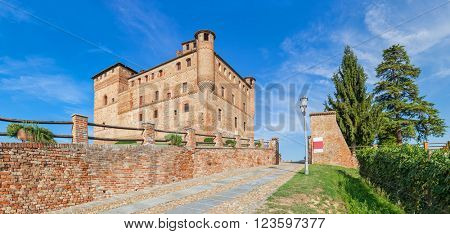 Old medieval construction under blue sky in Piedmont, Northern Italy (panorama).