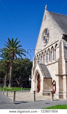FREMANTLE,WA,AUSTRALIA-FEBRUARY 21,2015: St. John's Anglican Church with it's limestone brick construction with palm trees under a blue sky in Fremantle, Western Australia.