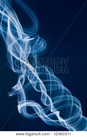 Jet of white smoke against a blue background