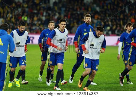 CLUJ-NAPOCA, ROMANIA - MARCH 27, 2016: Soccer players of the National Team of Spain exercising during the warm-up session before a match against Romania in Cluj Arena stadium