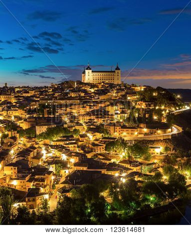 Panorama shot of Toledo Cityscape with Alcazar at dusk in Madrid Spain