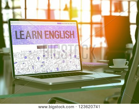 Learn English Concept. Closeup Landing Page on Laptop Screen in Doodle Design Style. On Background of Comfortable Working Place in Modern Office. Blurred, Toned Image. 3D Render.