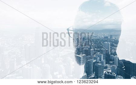 Photo of stylish bearded lawyer wearing trendy suit and looking city. Double exposure, panoramic view contemporary City background. Space for your business message.