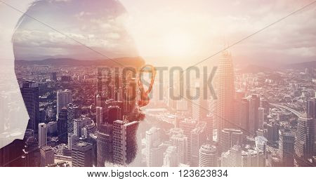 Closeup photo of stylish bearded banker wearing glasses and looking city. Double exposure, panoramic view contemporary megalopolis background. Space for your business message.