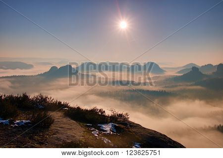 Dreamy Misty Landscape. Majestic Mountain Cut The Lighting Mist. Deep Valley Is Full Of Colorful Fog