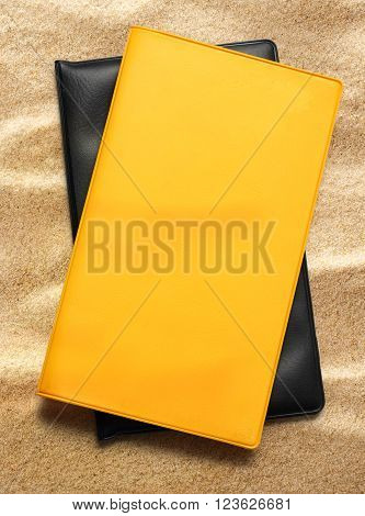 Yellow Blank Book On Sand
