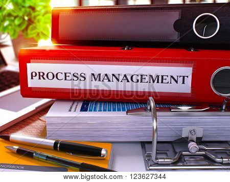 Process Management - Red Office Folder on Background of Working Table with Stationery and Laptop. Process Management Business Concept on Blurred Background. Process Management Toned Image. 3D.