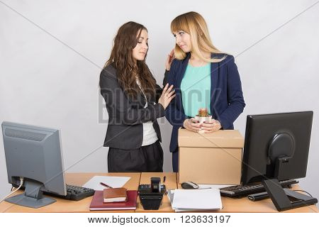 Office Worker Comforting Colleague Dismissed