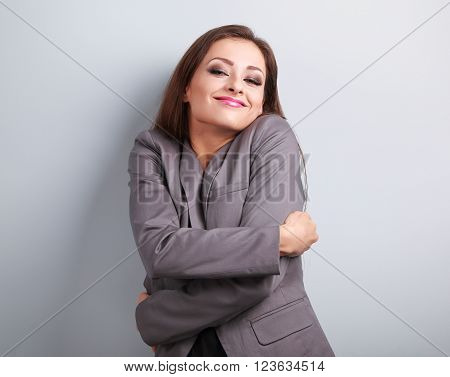 Enjoying Business Woman Hugging Herself With Natural Emotional Face. Love Concept Of Yourself.