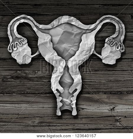 Uterus and ovaries with fallopian tubes concept as cut crumpled paper shaped as a human female reproduction symbol of fertility and reproductive system health.