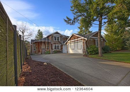 Cedar Home With Driveway And Fence