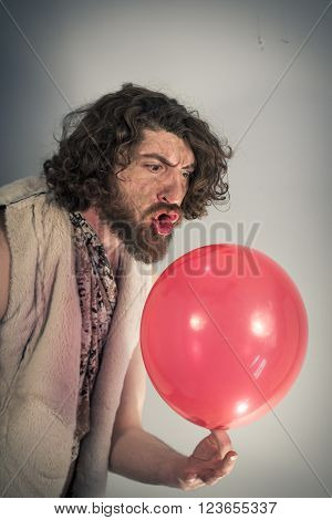 Silly caveman grunts at confusing red birthday balloon