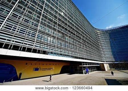 BRUSSELS BELGIUM - MARCH 16: Man walks by the European Commission Headquarters also know as the Berlaymont building on March 16 2016 in Brussels.
