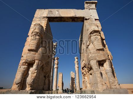 SHIRAZ, IRAN - SEPTEMBER 17, 2014: People passing through Gate of All Nations in Persepolis ancient city. construction of this city began at 518 BC under rule of King Darius from Achaemenid dynasty.