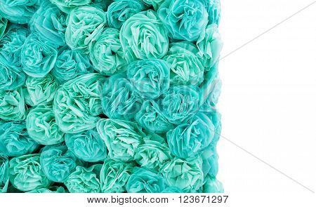 turquoise paper pom-poms and a place for your text.