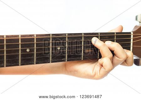 Woman's hands playing acoustic guitar, stock photo