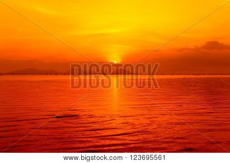 Fantastic view of the sea. Colorful sunset in the sea, orange sky background. Reflection of sun in water. Beautiful nature in the evening. Outdoors.