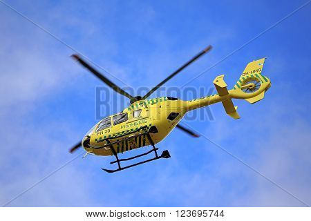 SALO, FINLAND - MARCH 27, 2016: FinnHEMS medical helicopter in flight. FinnHEMS is an abbreviation for Finnish Helicopter Emergency Medical Services.