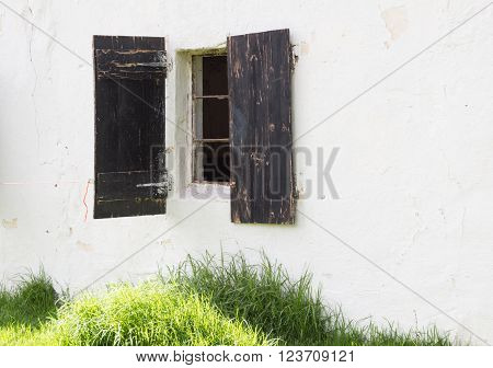 Shot of old horse stable window in building