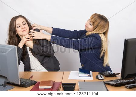 The Girl In The Office Workplace Trying To Stifle A Colleague