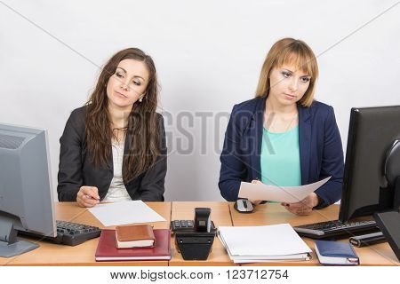 Employees Of The Office Sitting At A Desk With A View Of The Downtrodden