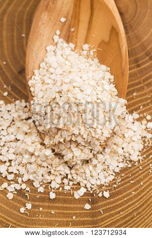 Quinoa flakes on a wooden background. macro view