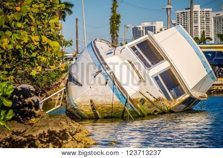 an abandoned boat rotting in the water