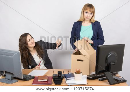 Office Woman With A Humiliating Gesture Unsettled The Dismissed Colleague