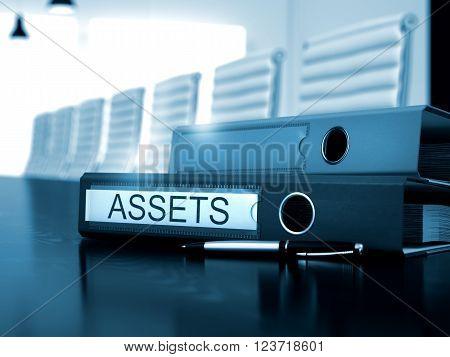 Assets - Business Illustration. Assets - Office Binder on Black Desktop. Assets. Business Concept on Toned Background. 3D Render.