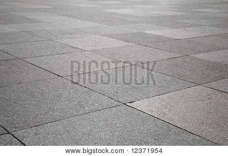 Rough texture of wet block pavement