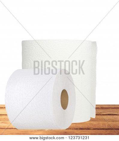 rolls of toilet paper on table isolated on white background