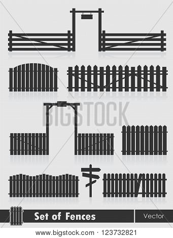 Set of black fences with gate isolated over grey background.