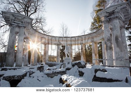 Colonnade of Apollo in Pavlovsk Park at sunset - sanctuary of the Greek God of the sun and patron of arts. Historic architecture. Landscape Park Museum in Pavlovsk, Saint Petersburg.  Apollo Belvedere