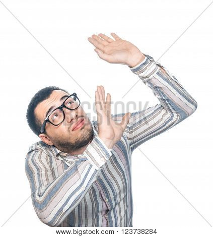 Frightened young man showing his hends. Man have a fear. Guard oneself, isolated on white background, studio shot.