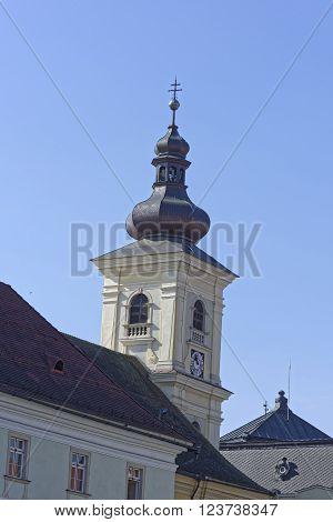 Catholic Church Sibiu Romania tower on blue sky medieval architecture