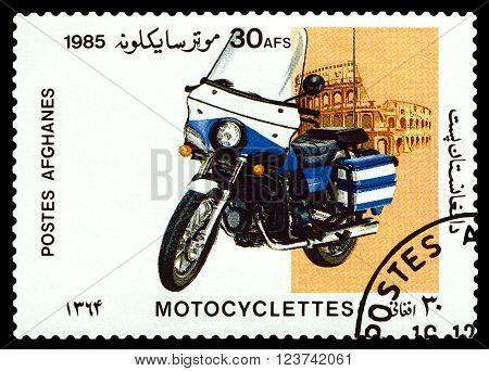 STAVROPOL RUSSIA - MARCH 30 2016: a stamp printed in Afghanistan shows an motorcycle against the backdrop of the Coliseum stamp devoted to the centenary of the invention of motorcycle cirka 1985