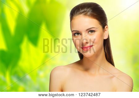 Young girl on spring floral background