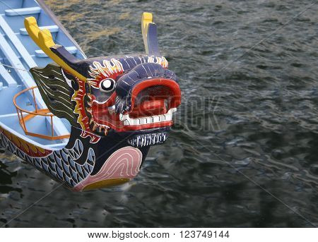 The prow of a rowing boat in the form of a dragon,  in Capetown South Africa.