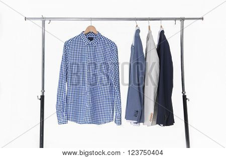 Set of men's suits hanging