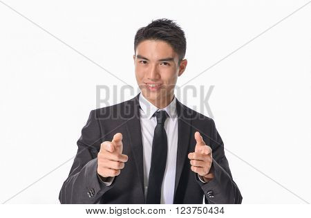 Full young business man touching an imaginary screen or button on white background