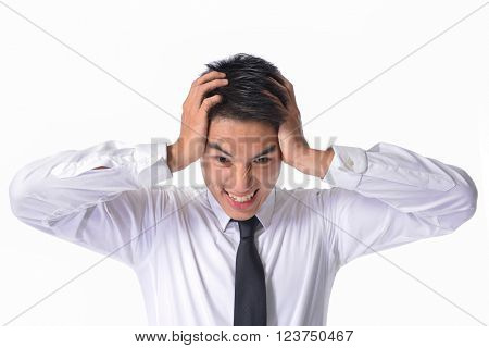 Portrait of young unhappy businessman holds his head, stress,