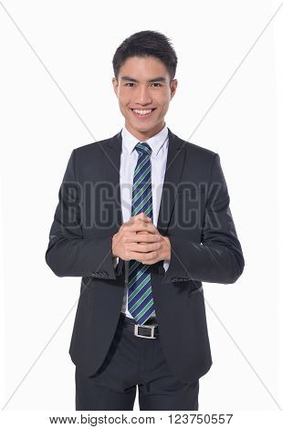 A confident young businessman stands â??white background