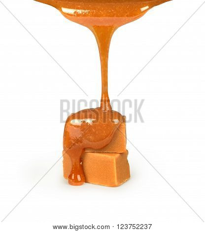 Caramel pouring on candies isolated on a white background