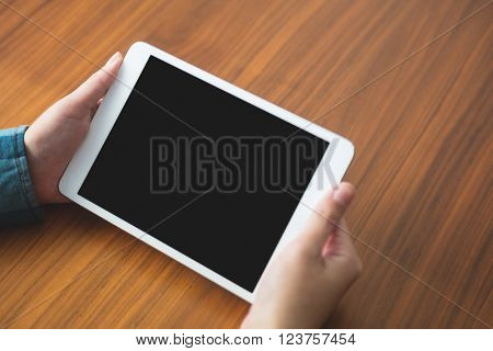 Woman holding a digital tablet at home