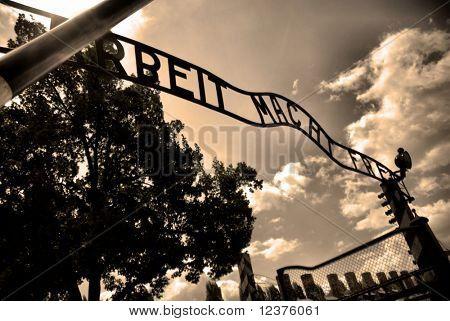 Auschwitz gate entrance. Old style photo of Auschwitz camp