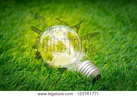 light bulb grow in the grass  with travel place (Japan,France,Italy,New York,India,egypt)