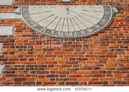 sundial -old town hall in Sandomierz, Poland. The town hall was build in the XIV century and the tower was build in the XVII century.