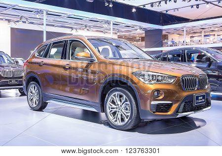 Bangkok - March 22 : orange BMW series X1 sDrive 18d - in display at The 37th Bangkok international Motor Show 2016 on March 22 2016 in Bangkok Thailand