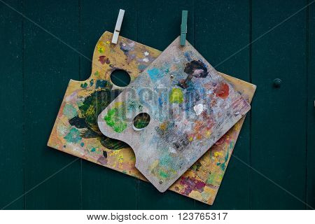 Artist palettes smeared with paint.