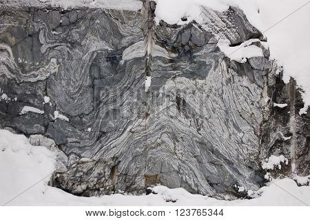 Stone background closeup texture of marble at winter outdoors